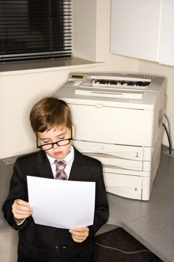 1119 young boy in suit with fax machine