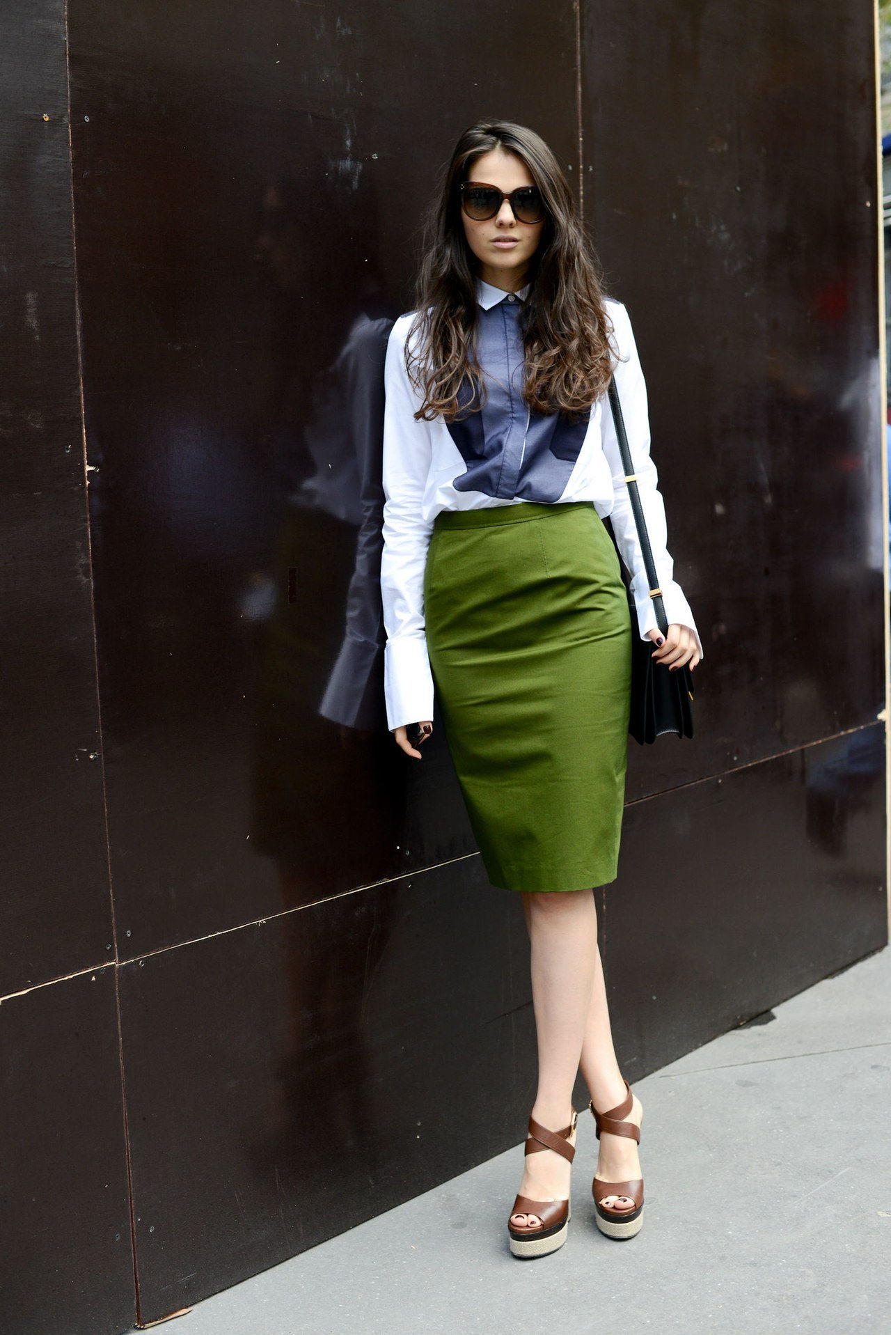 ΕΝΑ Green Pencil Skirt, a Blue Bib-Front Shirt, and Brown Sandals